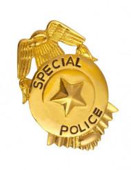 Guldfärgad polisbricka