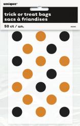 Små genomskinliga godispåsar med  orange och svarta prickar Halloween