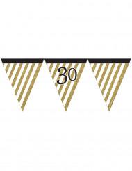 Stilig vimpelgirland i svart och guld till 30-årsfesten
