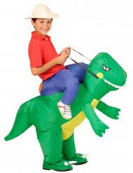 Upptäcksresande på en uppblåst dinosaurie Barn