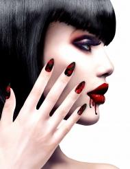 Svarta lösnaglar med blodfläckar