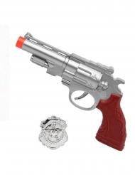 Silvrig pistol med polisbricka